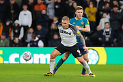Derby County forward Martyn Waghorn holds off Hull City defender Eric Lichaj during the EFL Sky Bet Championship match between Derby County and Hull City at the Pride Park, Derby, England on 18 January 2020.