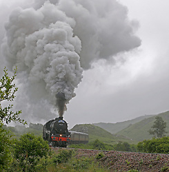 "Also known as the ""Hogwarts Express"" the Jacobite steam train operates between Fort William and Mallaig on what is often described as the greatest railway journey in the world. Here the Jacobite steam train is seen working hard on the ascent from Glenfinnan.  (c) Stephen Lawson 
