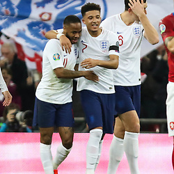Raheem Sterling of England celebrates his goal