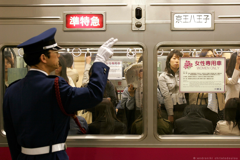 "Station attendand in front of the women-only car of KEIO line,  during the evening hours. In Tokyo, Wednesday 11 May, 2005.. In an attempt to combat the growing problem of gropers assaulting women in jam-packed trains, nine private railways and subway trains operated by the Tokyo metropolitan government introduced ""women only"" cars Monday during the morning rush hour."