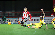 Milton Keynes Dons midfielder Carl Baker challanging Brentford defender Jake Bidwell for the ball during the Sky Bet Championship match between Brentford and Milton Keynes Dons at Griffin Park, London, England on 5 December 2015. Photo by Matthew Redman.