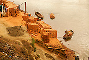 Madagascar, Analamanga region, clay brick production on the river bank near Antananarivo,