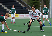 AMSTELVEEN - Brent van Bijnen (Adam) met Justen Blok (Rdam)  tijdens  de hoofdklasse hockeywedstrijd Amsterdam-HC Rotterdam (7-1).    COPYRIGHT KOEN SUYK