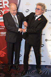 Grosvenor House Hotel, London, November 7th 2016. Luminaries from the music industry gather at the Grosvenor House Hotel for the Music Industry Awards, where this year The Who's Roger Daltrey CBE is honored with the 25th annual MITS award in support of Nordoff Robbins and The BRIT Trust. PICTURED: Harvey Goldsmith and Roger Daltrey (R)