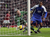 Photo: Paul Thomas.<br /> Manchester United v Wigan Athletic. The Barclays Premiership. 26/12/2006.<br /> <br /> Wigan goal keeper Chris Kirkland (Green) saves a Wayne Rooney shot (L) just!!
