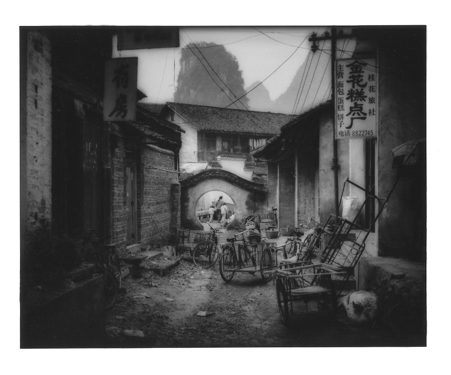 Cluttered alleyway.  Yangshuo, Guangxi Province, China.  1998