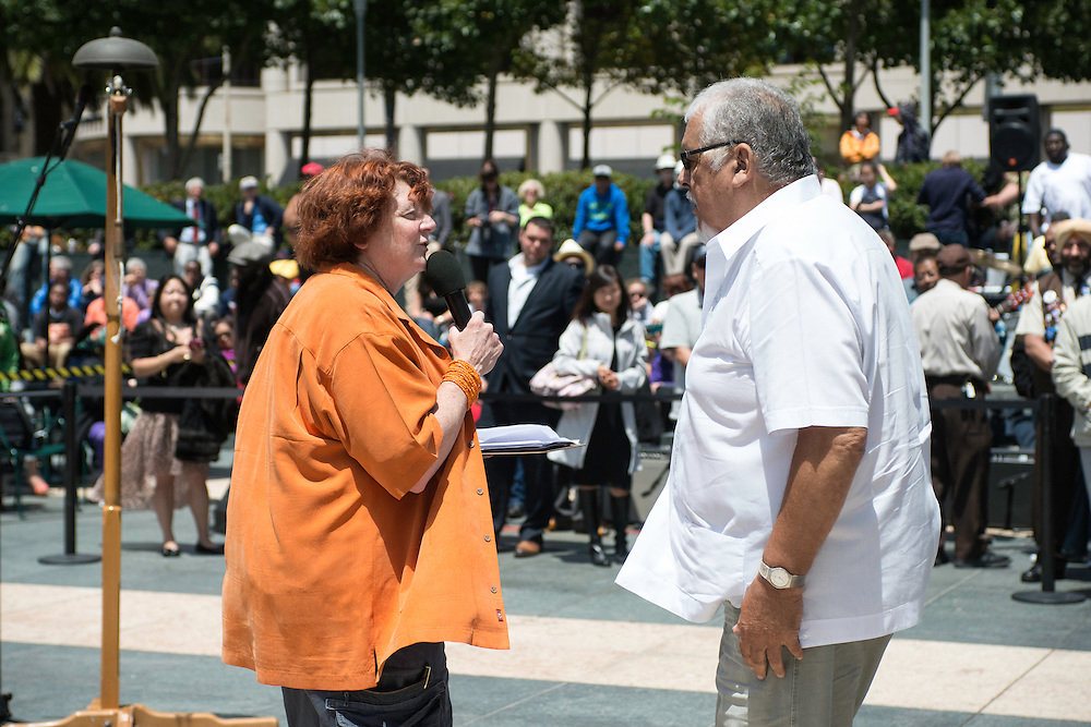 Debi Durst, comedienne and MC, talks to Al Quintana, four time former Bell Ringing Champion at the 50th Cable Car Bell Ringing Competition in San Francisco's Union Square | July 11, 2013