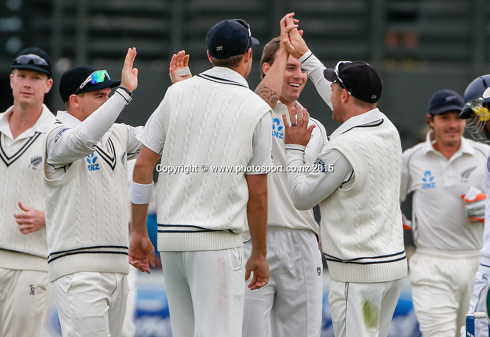 Doug Bracewell and New Zealand celebrate the wicket of Lahiru Thirimanne.  First day, second test, ANZ Cricket Test series, New Zealand Black Caps v Sri Lanka, 03 January 2015, Basin Reserve, Wellington, New Zealand. Photo: John Cowpland / www.photosport.co.nz