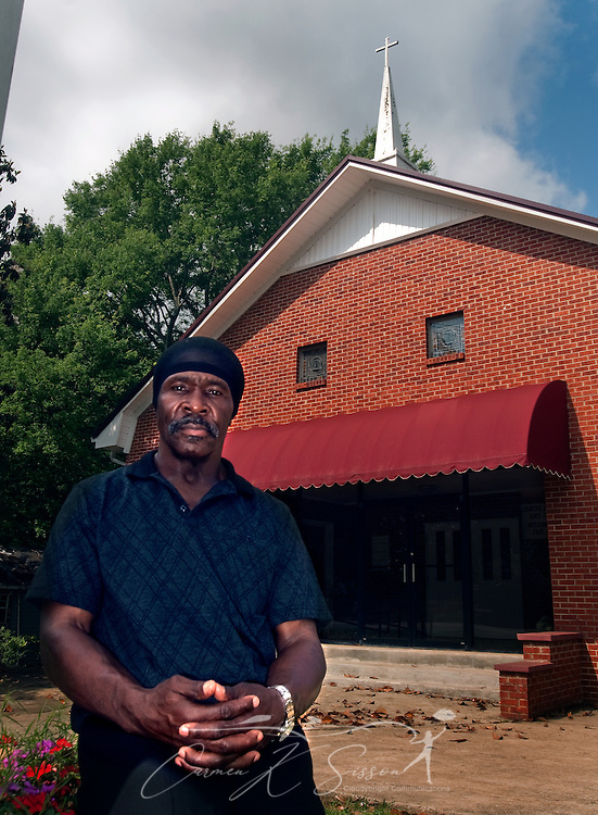 Johnny Holley Jr. poses in front of Beard Chapel AME Zion Church in Tuscaloosa, Ala. May 8, 2009. Holley, 63, was released from prison in April after serving 29 years of a life without parole sentence for armed robbery in the first degree. Holley, who was sentenced under the three strikes law for stealing a toolbox from a church parking lot in 1980, was allowed to go free following the Alabama Legislature's 2000 decision to ease mandatory sentences for non-violent, repeat offenders. (Carmen K. Sisson/Cloudybright)