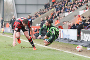 Rhys Murphy of AFC Wimbledon is tackled by Chris Doyle of Morecambe FC during the Sky Bet League 2 match between Morecambe and AFC Wimbledon at the Globe Arena, Morecambe, England on 12 March 2016. Photo by Stuart Butcher.