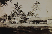 Traditional village with round huts with thatched roofs at Tautira, Tahiti, during the reign of Pomare V, 1839-91, the last King of Tahiti, photograph, 1885-89, by G Spitz, in the MTI-TFM Collection (fonds de la Polynesie Francaise), in the Musee de Tahiti et des Iles, or Te Fare Manaha, at Punaauia, on the island of Tahiti, in the Windward Islands, Society Islands, French Polynesia. The Museum of Tahiti and the Islands was opened in 1974 and displays collections of nature and anthropology, habitations and artefacts, social and religious life and the history of French Polynesia. Picture by Manuel Cohen