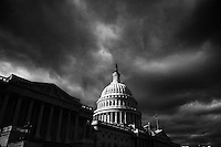 The US Capitol Building under cloudy skies in Washington, DC on January 25, 2006. Black and white.