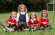 BIGGLESWADE, ENGLAND - AUGUST 18: The UK's only identical quadruplets (l-r) Ellie Carles, Holly Carles, Georgie Carles and Jessica Carles, aged five, have been recruited by Sainsbury's to test school uniforms by putting them through rigorous checks on August 18, 2011 in Biggleswade, England.  The girls, alongside Mum Julie Carles will provide feedback to the retailer over the forthcoming academic year.  (Photo by Tim Whitby/Getty Images)