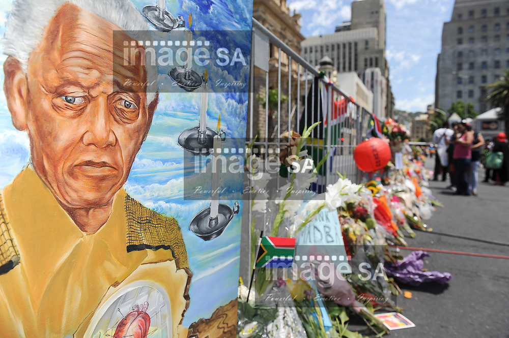 CAPE TOWN, SOUTH AFRICA - Saturday 7 December 2013, a member of the public attached a large painting to the barricade during a time of national mourning the death of the first democratically elected president, Nelson Mandela, in front of the Cape Town City Hall.<br /> Photo by Roger Sedres/ImageSA