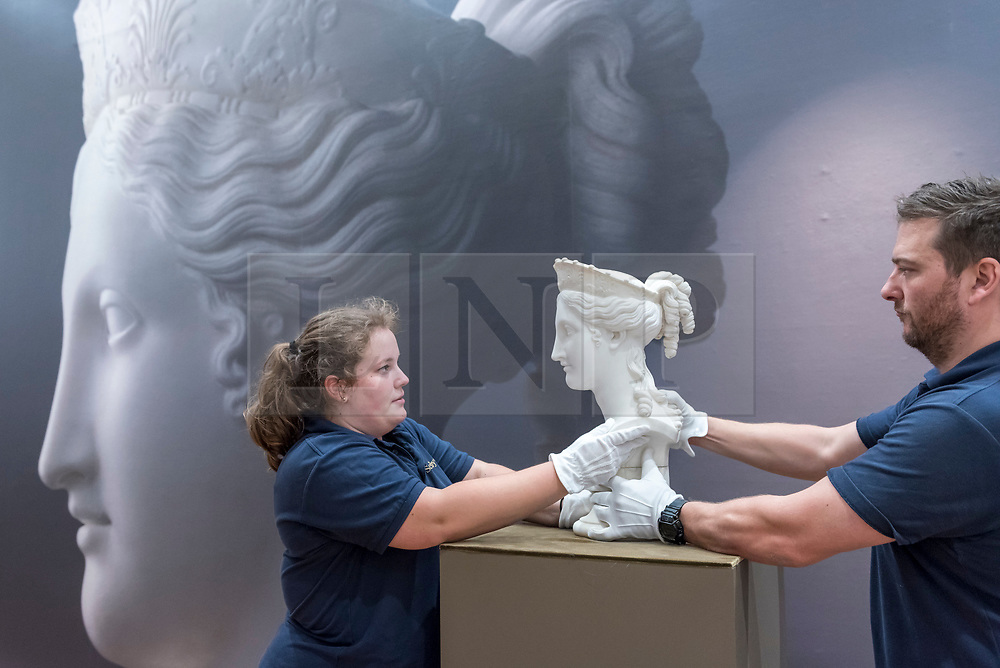 "© Licensed to London News Pictures. 29/06/2018. LONDON, UK. Staff members present ""Bust of Peace"" by Antonio Canova (Est. in excess of £1m).  Preview of Old Masters, British, Treasures, Sculptures and Ancient works at Sotheby's New Bond Street to be offered for sale on 3 and 4 July 2018.  Photo credit: Stephen Chung/LNP"
