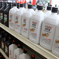 An assortment of motor oils is among the several auto parts available at the store.