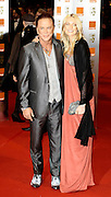 21.FEBUARY.2010.LONDON<br /> <br /> MICKY ROURKE AND WOMEN FRIEND ARRIVING AT THE ORANGE BRITISH ACADMEY AWARDS 2010 AT THE ROYAL OPERA HOUSE, COVENT GARDEN<br /> <br /> *THIS IMAGE IS STRICTLY FOR UK NEWSPAPERS &amp; MAGAZINES ONLY*<br /> *FOR WORLDWIDE SALES &amp; WEB USE PLEASE CONTACT EDBIMAGEARCHIVE - 0208 954 5968*