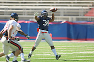 Ole Miss' Brandon Bolden (34) looks to pass during a scrimmage at Vaught-Hemingway Stadium in Oxford, Miss. on Saturday, April 2, 2011.