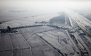 Nederland, Noord-Holland, Abcoude, 07-01-2010; winterlandschap met mist en tegenlicht ter hoogte van Abcoude, zicht op polder Groenland met rechts de A2..Winter landscape with fog and backlight near Abcoude, view of Greenland polder, to the right A2 motorway.luchtfoto (toeslag), aerial photo (additional fee required).foto/photo Siebe Swart