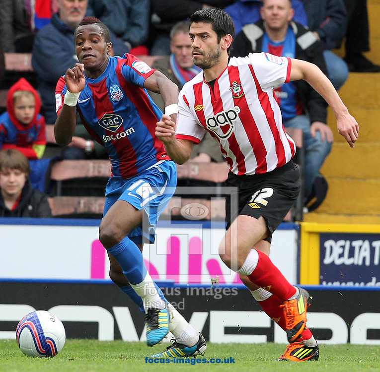 Picture by Paul Terry/Focus Images Ltd. 07545642257.09/04/12.Wilfried Zaha of Crystal Palace and Danny Butterfield of Southampton during the Npower Championship match at Selhurst Park stadium, London.