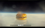 This burger is out of this world! Five bored Harvard students send whopper into space<br /> <br /> A group of five bored Harvard University students put their $40,000-a-year Ivy League education to good use by launching the first ever hamburger into the upper reaches of the atmosphere.<br /> The students, juniors Renzo Lucioni, Nuseir Yassin, Daniel Broudy, Jamie Law-Smith and Matt Moellman, spent a weekend last month brainstorming ideas for a fun science project to break the monotony of school.<br /> In the end, the Ivy League innovators decided to send a hamburger into space as part of Operation: Skyfall. To accomplish their goal, they contacted Jon Olinto, the co-founder of the local eatery b.good burger.<br /> <br /> Olinto jumped on the opportunity to become a restaurant industry space pioneer and rushed to write the Harvard wiz kids a check for $1,000 to finance the experiment, ABC News reported.<br /> Lucioni told Boston.com he was inspired to launch the whopper after reading about MIT students who sent a camera into space via helium balloon in 2009.<br /> It took the group about 30 hours spread over two weekends to prepare the launch, which required gluing the layers of a two-day-old hamburger together, varnishing it, mounting it on an acrylic pedestal, placing it inside a Styrofoam shipping crate and attaching the whole structure to a 600-gram weather balloon filled with helium.<br /> The b. good burger was launched into space from a wooded area of Sturbridge, Massachusetts, at around 12.20pm on October 27. It took the balloon carrying the patty meal two hours to reach an altitude of more than 98,000feet, or 19 miles, and an hour to plummet back to Earth.<br /> The contraption carrying the trailblazing treat was recovered 130 miles north of Boston using GPS data transmitted by the smartphone.<br /> The balloon landed high up in a 100-foot tree, forcing b. good burger to hire a tree climber to retrieve it after a failed attempt to shoot it down with a bow and arrow.<br /> But by the time the box was on solid ground, the sandwich