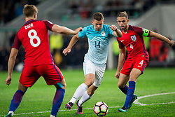 Roman Bezjak of Slovenia between Eric Dier of England and Jordan Henderson of England during football match between National teams of Slovenia and England in Round #3 of FIFA World Cup Russia 2018 Qualifier Group F, on October 11, 2016 in SRC Stozice, Ljubljana, Slovenia. Photo by Vid Ponikvar / Sportida