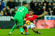 Marcus Rashford (#10) of Manchester United stretches to try to prod the ball beyond the advancing Martin Dubravka (#12) of Newcastle United during the Premier League match between Newcastle United and Manchester United at St. James's Park, Newcastle, England on 2 January 2019.