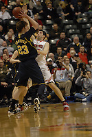 Ohio State forward Jon Diebler (33) plays tight defense on Michigan forward Evan Smotrycz (23) in the first half of the Big Ten Tournament semifinals in Indianapolis, on March, 11, 2011, at Conseco Fieldhouse. Ohio State defeated Michigan 68-61.