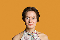 Portrait of a happy mid adult woman over colored background