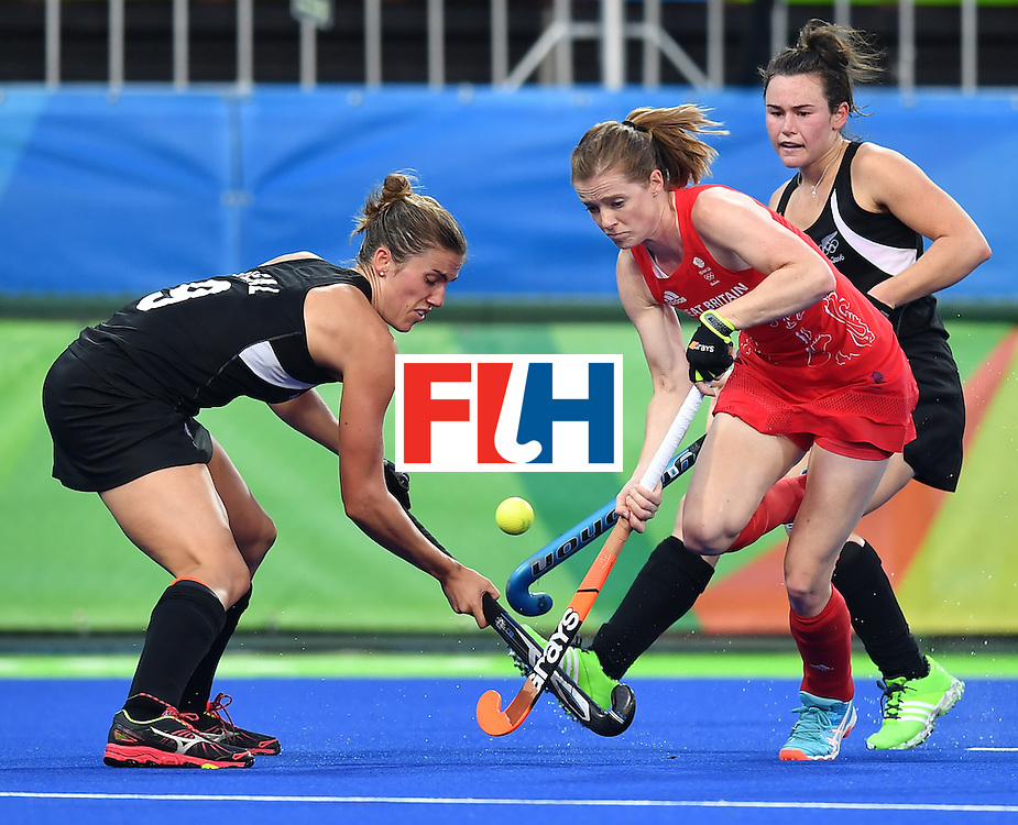 New Zealand's Brooke Neal (L) and New Zealand's Kelsey Smith (R) vie with Britain's Giselle Ansley during the women's semifinal field hockey New Zealand vs Britain match of the Rio 2016 Olympics Games at the Olympic Hockey Centre in Rio de Janeiro on August 17, 2016. / AFP / MANAN VATSYAYANA        (Photo credit should read MANAN VATSYAYANA/AFP/Getty Images)
