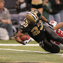 2008 December, 07: New Orleans Saints running back Pierre Thomas (23) falls over the goal line for a touchdown as Atlanta Falcons safety Erik Coleman (26) attempts to make a tackle during a 29-25 victory by the New Orleans Saints over NFC South divisional rivals the Atlanta Falcons at the Louisiana Superdome in New Orleans, LA.
