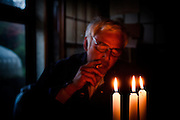 Tomioka, May 2 2012 - Naoto Matsumura, 52, refuses to leave the Fukushima nuclear evacuation zone. Since April 2011, he lives alone in his house without electrcicity and takes care of pets in the area. At night, eating can, drinking sake smoking with candles.