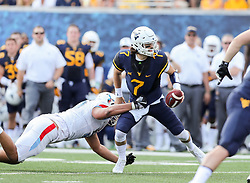 Sep 16, 2017; Morgantown, WV, USA; Delaware State Hornets offensive lineman Jacob Jones (58) sacks West Virginia Mountaineers quarterback Will Grier (7) during the first quarter at Milan Puskar Stadium. Mandatory Credit: Ben Queen-USA TODAY Sports