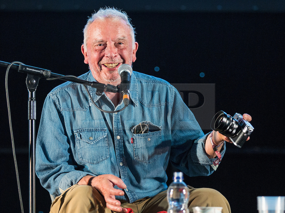 """© Licensed to London News Pictures. 18/07/2014 . Henham Park , Suffolk , United Kingdom . Photographer DAVID BAILEY CBE discusses a recent exhibition of his work at the National Portrait Gallery entitled """" Stardust """" and talks about his career , on the Film and Music stage at the Latitude Festival of music and arts . Photo credit : Joel Goodman/LNP"""