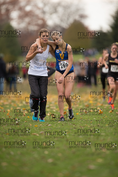 Brittany King of Victoria Vikes is helped by a supporter after collapsing during the women's  6K Dash at the 2013 CIS Cross Country Championships in London Ontario, Saturday,  November 9, 2013.<br /> Mundo Sport Images/ Geoff Robins