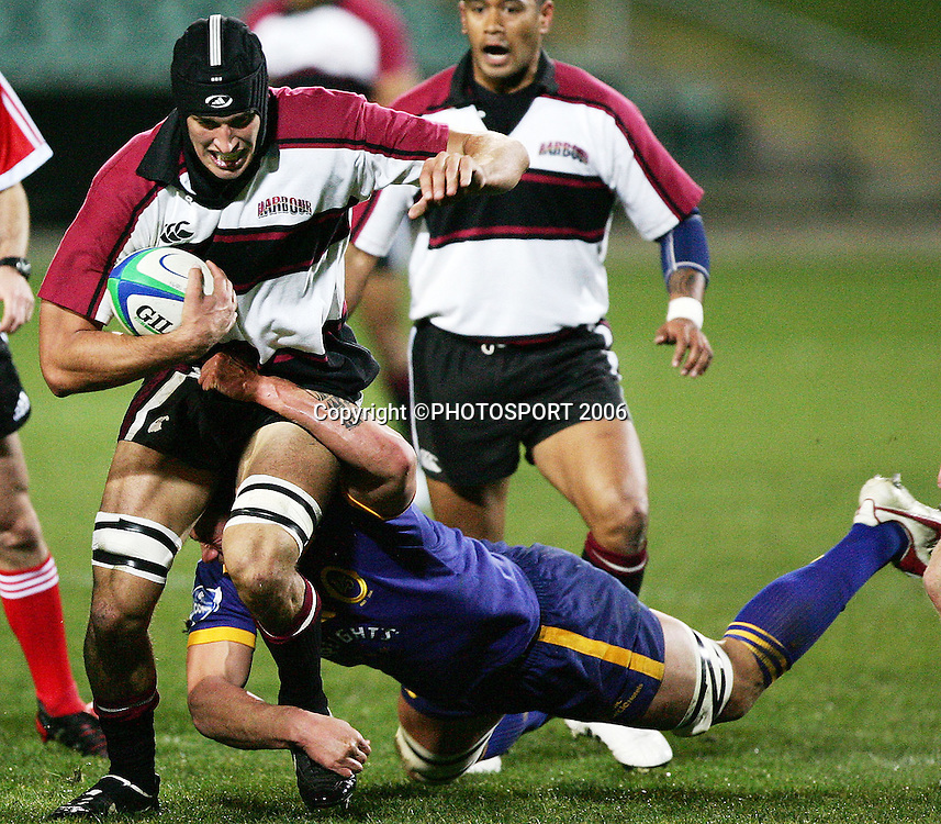 Harbour flanker Anthony Boric is tackled during the Air New Zealand Cup pre season game between QBE Insurance North Harbour and Speight's Otago held at North Harbour Stadium in Auckland, New Zealand on Friday 14 July 2006. Photo: Tim Hales/PHOTOSPORT
