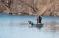 """Peter, Mike and John Poulin in their """"Fishing Machine"""" have a fish on the line during opening day of landlocked fishing season Wednesday morning.  (Karen Bobotas/for the Laconia Daily Sun)"""