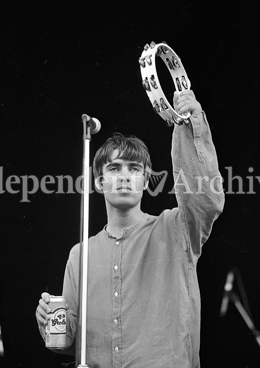 Liam Gallagher of Oasis on stage at Slane during their concert, 22/07/1995 (Part of the Independent Newspapers Ireland/NLI Collection).