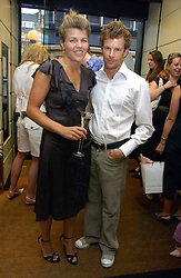 AMBER NUTTALL and TOM AIKENS at a party hosted by Links at their store in Sloane Square, London to celebrate the forthcoming Glorious Goodwood Racing festival held on 26th July 2006.<br />