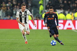 November 27, 2018 - Turin, Piedmont, Italy - Francis Coquelin (Valencia CF) and Mario Mandzukic (Juventus FC) during the UEFA Champions League match between Juventus FC and Valencia CF, at Allianz Stadium on November 27, 2018 in Turin, Italy. .Juventus won 1-0 over Valencia. (Credit Image: © Massimiliano Ferraro/NurPhoto via ZUMA Press)
