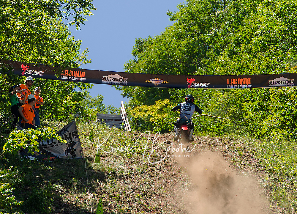Nick Bleau approaches the top of the hill during Gunstock's Hill Climb event on Wednesday.  (Karen Bobotas/for the Laconia Daily Sun)