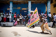 A boy holding the flag representing the #3 Asafo company dances on the street during the parade held on the occasion of the annual Oguaa Fetu Afahye Festival in Cape Coast, Ghana on Saturday September 6, 2008...