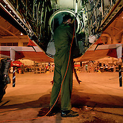 Propulsion engine specialist inspects internal Hawk of the 'Red Arrows', Britain's Royal Air Force aerobatic team.