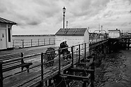 Old man on pier - Southend on Sea in December