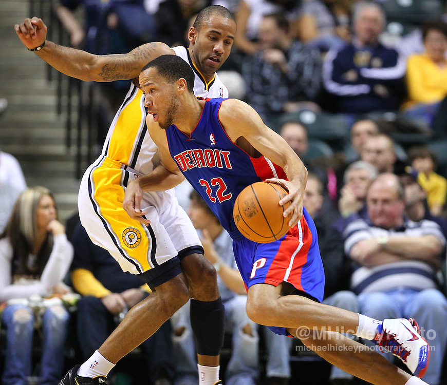 Feb. 23, 2011; Indianapolis, IN, USA; Detroit Pistons small forward Tayshaun Prince (22) drives around Indiana Pacers guard Dahntay Jones (1) at Conseco Fieldhouse. Mandatory credit: Michael Hickey-US PRESSWIRE