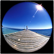 March 12, 1996  •  pier in Key West, FL  •  Jan Tinkley  •  Nikon 7.5mm Fisheye  •  Nikon assignment (Tokyo)  •  model released