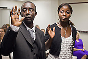 June 21, 2010 - PHOENIX, AZ: REGINALD NEWLOVE (left) from Sierra Leone, and TABITHA MAMATTAH, from Liberia, take the oath of citizenship during a naturalization ceremony for former refugees at the International Rescue Committee offices in Phoenix, AZ, Monday, June 21. World Refugee Day was Sunday, June 20; the IRC and US Citizenship and Immigration Services offices  marked the day by holding a naturalization ceremony for 10 people who came to the US as refugees.  Photo by Jack Kurtz
