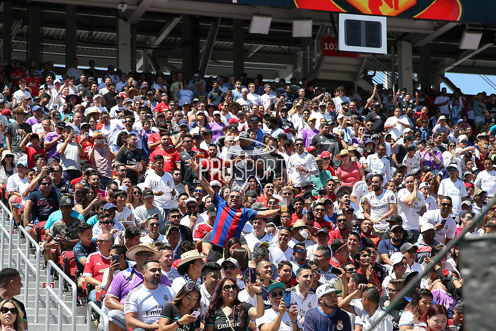Barcelona fan with Real Madrid fans during the AON Tour 2017 match between Real Madrid and Manchester United at the Levi's Stadium, Santa Clara, USA on 23 July 2017.