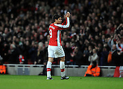 Eduardo of Arsenal salutes the Arsenal fans during the FA Cup 4th Round Replay between Arsenal and Cardiff City at the Emirates Stadium on February 16, 2009 in London, England.