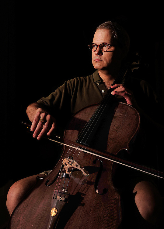 Dan Schab poses with his favorite cello after a thief returned the $10,000 instrument a few weeks after it was stolen from his instrument shop in Athens, Ga. on Friday, July 30, 2010.  .